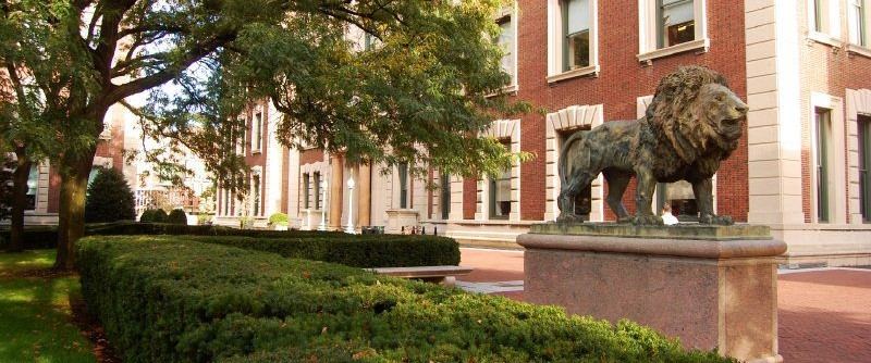 View of statue of lion in front of Havemeyer Hall and lawn