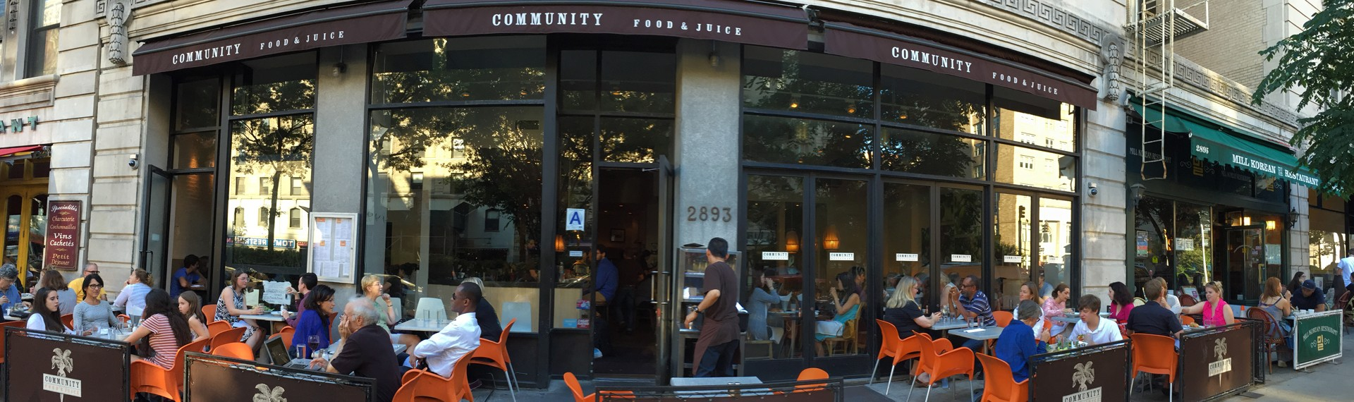 Patrons sitting outside at Community Food & Juce